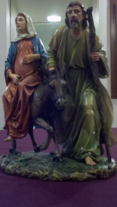 Mary with child & Joseph on their way to Bethlehem